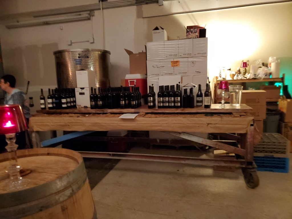 A photo of a table with wine bottles on it, all of the wines we'd be sampling that day.