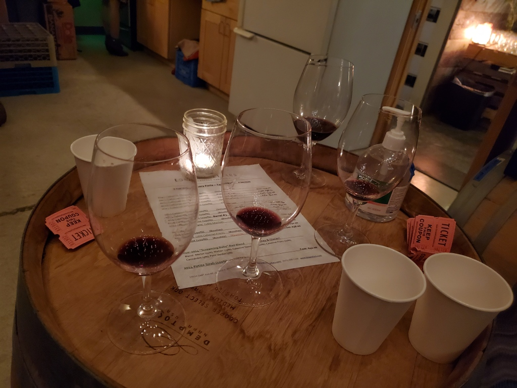 A photo of 4 wine glasses, filled with a tasting-sized portion of wine in each.