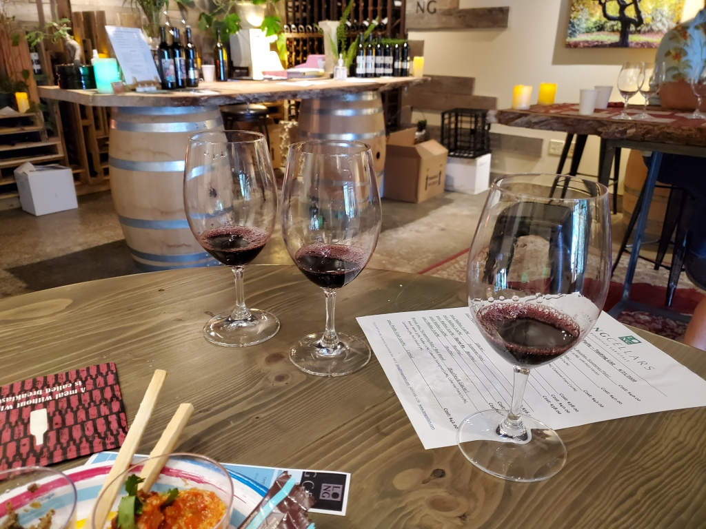 A flight of 3 wines ready for tasting.